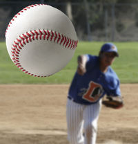 Bigstockphoto_youth_pitcher_and_baseball_1941527.s600x600